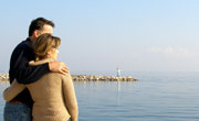 Couple relaxing by sea shore